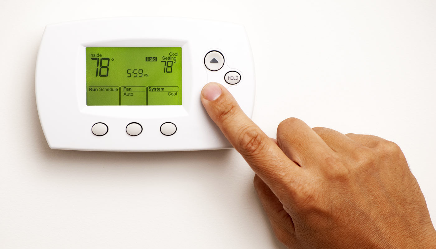 how low should i set my thermostat while out of town - dominion